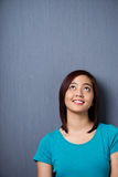 Young Asian woman standing daydreaming Royalty Free Stock Photography