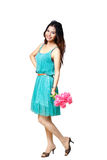 Young asian woman standing with a flowers in her hand. Isolated over white with clipping path stock image