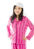 Young Asian woman standing with her arms akimbo Royalty Free Stock Photo