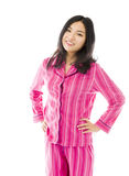 Young Asian woman standing with her arms akimbo Royalty Free Stock Photography