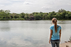 Young Asian woman standing at Lake. Asian woman standing at Lake Stock Images