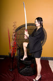 Young Asian Woman Standing with Sword Stock Image