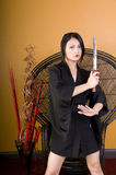 Young Asian Woman Standing with Sword Royalty Free Stock Image