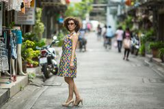 Young asian woman stands on the street. Travel. Young asian woman stands on the street Royalty Free Stock Photography