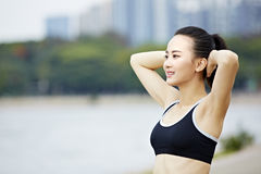 Young asian woman streching arms before exercise royalty free stock photos