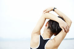 Young asian woman stretching arms before exercise stock photos