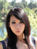 Young Asian woman with surpised look Stock Photography