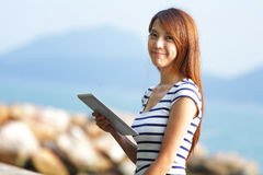 Young asian woman with tablet Stock Image