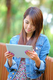 Young asian woman with tablet computer Royalty Free Stock Photo