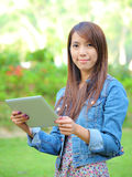 Young asian woman with tablet pc Royalty Free Stock Images