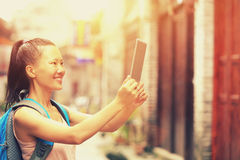 Young asian woman taking photo using digital tablet Royalty Free Stock Image