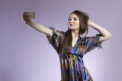 Young asian woman taking picture of herself Stock Image