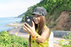 Young Asian woman taking selfie with nature view. Stock Photos