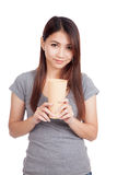 Young Asian woman with tall plastic glass. Isolated on white background Royalty Free Stock Images