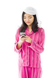Young Asian woman text messaging on a mobile phone Royalty Free Stock Images