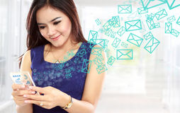 Young asian woman texting message Royalty Free Stock Photos
