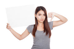 Young Asian woman thumbs down with blank sign Stock Photos