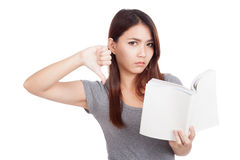 Free Young Asian Woman Thumbs Down With A Book Royalty Free Stock Images - 48636909