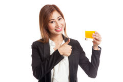 Young Asian woman thumbs up drink orange juice Royalty Free Stock Images