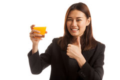 Young Asian woman thumbs up drink orange juice. Royalty Free Stock Photo