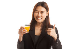 Young Asian woman thumbs up drink orange juice. Royalty Free Stock Photos