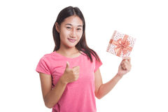 Young Asian woman thumbs up with a gift box. Royalty Free Stock Photo