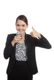 Young Asian woman thumbs up with a glass of drinking water Stock Images