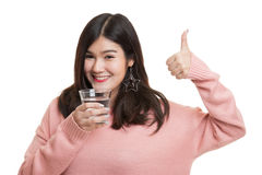 Young Asian woman thumbs up with a glass of drinking water. stock images