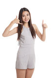 Young Asian woman thumbs up show with phone gesture Stock Photography