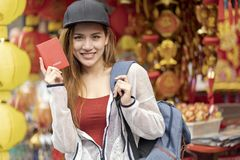 Young asian woman traveler bag backpacker holding red passport for travel trip vacation royalty free stock photography