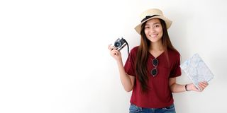 Young asian woman traveler holding vintage camera and map with copy space, people summer holiday vacation background concept royalty free stock photo
