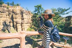 Young asian woman traveler travelling to wonderful soil cliff Ph. A Cho at Mae Wang National Park, Doi Lo district, Chiang Mai, Thailand royalty free stock photo