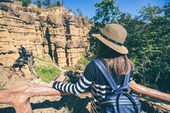 Young asian woman traveler travelling to wonderful soil cliff Ph. A Cho at Mae Wang National Park, Doi Lo district, Chiang Mai, Thailand royalty free stock photography