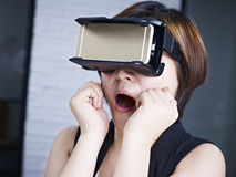 Young asian woman trying VR glasses Royalty Free Stock Photos