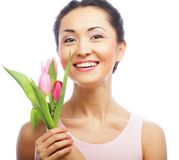 Young asian woman with tulips Royalty Free Stock Photo
