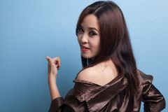 Young Asian woman turn back thumbs up. Royalty Free Stock Image