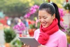 Young asian woman use digital tablet Royalty Free Stock Photos
