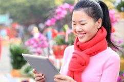 Young asian woman use digital tablet Royalty Free Stock Image
