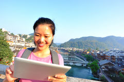 Young asian woman use tablet pc Stock Photos