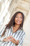 Young asian woman using a cell phone Royalty Free Stock Photography