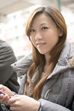 Young Asian woman using cellphone. Closeup portrait royalty free stock image