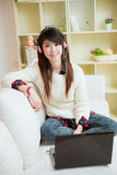 Young asian woman using laptop Royalty Free Stock Image