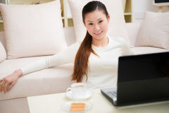 Young asian woman using a laptop Stock Photo