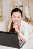 Young asian woman using a laptop Stock Photography