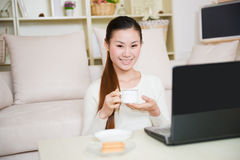 Young asian woman using a laptop Royalty Free Stock Photo