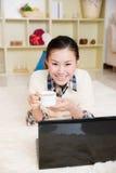 Young asian woman using a laptop Stock Photos