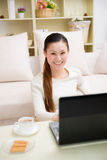 Young asian woman using a laptop Royalty Free Stock Photos