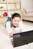 Young asian woman using a laptop Royalty Free Stock Photography