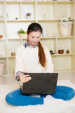Young asian woman using a laptop Royalty Free Stock Image