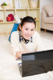 Young asian woman using a laptop Stock Images